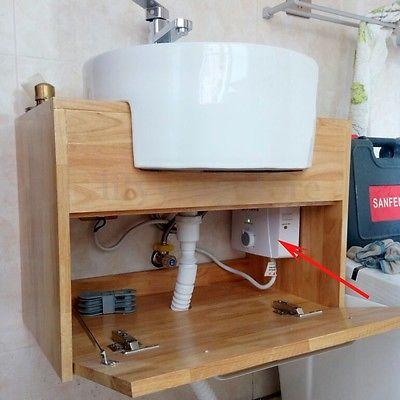 La mise en place c'un chauffe eau nouvelle génération sous le lavabo de la salle de bain